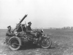 Polish troops on a Sokół 1000 motorcycle with a Ckm wz. 30 machine gun, 3 May 1938