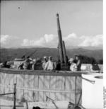 9 cm Flak 309/1(i) anti-aircraft gun and its German crew on the coast of the Gulf of La Spezia, Italy, Jul-Aug 1944