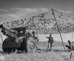 155 mm Howitzer Carriage M1917 or M1918 howitzer and crew in exercise, Camp Carson, Colorado, United States, 24 Apr 1943, photo 1 of 2