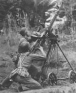 Chinese communist troops operating a DShK M1938 heavy machine gun as an anti-aircraft weapon, post-WW2