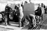 German coastal anti-aircraft gun crew replacing the barrels of a 2 cm Flakvierling 38 mount, possibly in France, circa 1942-1943