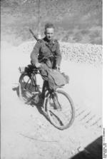 German soldier with bicycle and Gewehr 41 rifle, Balkan Peninsula, 1941
