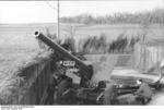German troops with a 10.5 cm K 35(t) field gun in France, Aug 1941, photo 1 of 2