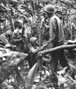 An US Marine mortar team shelling a Japanese position somewhere in the Pacific, date unknown; note the near-verticle angle of the M1 Mortar barrel and the M1 Carbine