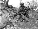Private First Class Julias Van Den Stock of Company A, 32nd Regimental Combat Team, US 7th Infantry Division with M1 or M2 Carbine with captured Communist Chinese DP light machine gun on Hill 902, near Ip-Tong, Korea, 25 Apr 1951
