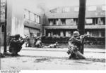 Soldiers of 44th Division, US 7th Army fighting in Mannheim, Germany, 29 Mar 1945; note bazooka and M1 Garand rifles