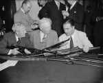 US Senator Morris Sheppard, Major General George Lynch, and Senator A. B. Chandler comparing M1941 Johnson rifles and the M1 Garand rifles, Washington, DC, United States, 29 May 1940