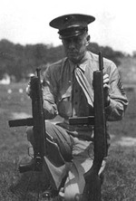 US Marine holding M55 Reising folding-stock (left) and M50 Reising (right) submachine guns, Marine Corps Base Quantico, near Triangle, Virginia, United States, date unknown
