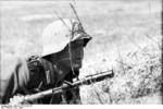 German soldier of Großdeutschland Division  near Achtyrka, Ukraine, Jun 1943; note Kar98k rifle with grenade launcher