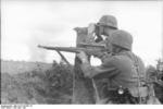 A German sniper (carrying Kar98k with 4x Zeiss ZF42 telescopic sight) and a spotter at Voronezh, Russia, Jun-Jul 1942