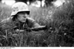 German paratrooper with Kar98k rifle with grenade launcher, France, summer 1944
