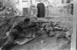 Polish resistance fighter with captured German Kar98k rifle, 13/15 Dluga Street, Warsaw, Poland, late Aug 1944