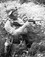 Nationalist Chinese Army soldier wearing a German-style helmet and a gas mask while wielding a Mauser C96 (M1932) pistol, date unknown