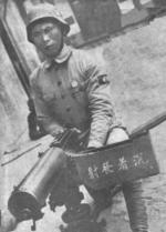 Chinese soldier posing with a Type 24 machine gun, date unknown