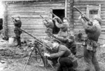 Soviet troops posing with PPSh-41 submachine guns and a captured German MG34 machine gun, date unknown
