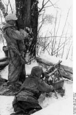 German MG42 machine gun crew in Russia, Jan 1944; Sturmgewehr 44 assault rifle