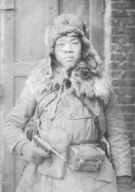 Japanese soldier in winter gear with Nambu Type 14 handgun, date unknown