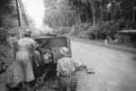 2 pounder gun of 4th Anti-Tank Regiment of Australian 8th Division on the Muar-Parit Sulong Road, Malaya, 18 Jan 1942; note knocked out Japanese Type 95 Ha-Go tank in distance