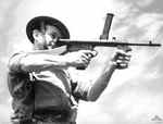 Australian soldier posing with an Owen Machine Carbine, date unknown
