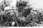 Camouflaged German paratrooper with Panzerfaust, France, Jun-Jul 1944