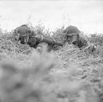British Rifleman Reg Oates and Sergeant James Woodward with a PIAT anti-tank launcher near Caen, France, 1944