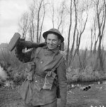 Private G. Mills of British 2nd Gloucestershire Regiment with a PIAT launcher, northwestern Europe, 6 Mar 1945
