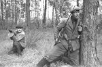 Byelorussian guerillas posing in a forest, circa 1943; note PPD-40 submachine gun, Mosin-Nagant M1891 rifle, and German bayonet