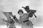 Soviet troops charging near Leningrad, Russia, 1 Jan 1943; note PPD submachine gun
