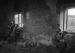Soviet Senior Sergeant Fominykh, Sergeant Khizmatulin, and another soldier firing from a position inside a wrecked building, Eastern Europe, Oct 1942