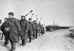Soviet anti-tank gunners with PTRD-41 rifles marching near Vyazma, Russia, 4 Mar 1943