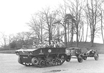 Light Dragon tractor towing a 3.7-inch howitzer on Carriage Mk IV and limber of A Battery, Royal Horse Artillery, circa 1938