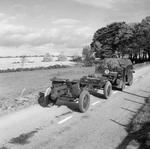 British Morris Quad vehicle towing an Ordnance QF 4.5 inch Howitzer of 51st Highland Division on the Huntly-Turniff road in Banffshire, Scotland, United Kingdom, 10 Oct 1940