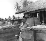 Malayan policeman with Sten gun at the police station in Pengkalan Kubor, Malaya, 22 Jul 1950