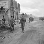 Troops of A Company, 6th Durham Light Infantry Regiment, British 50th Division in Grandcamp-Maisy, France, 11 Jun 1944; note Sten gun