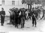 French militia escorting captured resistance fighters, France, Jul 1944