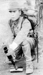 Japanese soldier posing with a Type 89 grenade launcher, date unknown