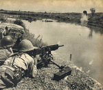Machine gun crew of Japanese 4th Division near Miluo River in Hunan Province, China, during Second Battle of Changsha, 22 or 23 Sep 1941
