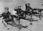 Chinese soldiers posing with captured Japanese Type 92 heavy machine guns, date unknown