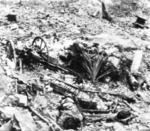 Japanese Type 94 anti-tank gun crew dead in a gun pit after the Battle for Munda Point on New Georgia, Solomon Islands, Aug 1943